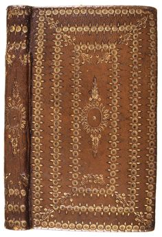 A binding by the Little Gidding Community (?), ca. 1641. Citron goatskin over pasteboards. Covers perhaps stenciled before gilt tooling.
