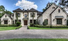 This French Country style stone & stucco home is located at 15 Hepplewhite Way in Spring, TX and is situated on 3/4 of an acre of land.