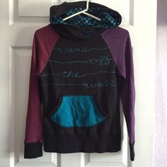 "Vans multicolored hoodie Excellent condition barely worn, vans hoodie states ""vans off the wall"" in cursive across the chest. Purple n pink sleeves, blue checkered hood, unique across neck pearled blue button style Vans Tops Sweatshirts & Hoodies"