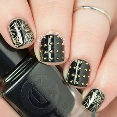 What a classic! Studded nails with stamping from @uberchicbeauty plate 2-02