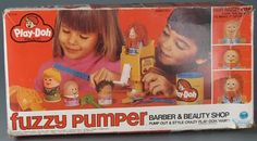 "Play-Doh Fuzzy Pumper Barber & Beauty Shop. Quite possibly what my Mom STILL considers to be the biggest gift-giving mistake of her life. I'm sure there was nothing more fun for her than having 6 or so kids in the kitchen, newspaper covering every square inch, and Play-Doh oozing out of every doll's orifice. The best part? The little dried up pieces of Play-Doh ""hair"" that would get stuck to the bottom of your sock the next day."