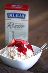 A tasty Italian rice pudding garnished with seasonal strawberries and a hint of cinnamon for a creamy, flavorful dessert.