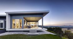 Nestled in hilltops with spectacular views of Byron Bay, this stylish, sustainable home embraces natural living and understated aesthetics with stunning results