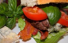 GORGONZOLA AND SMOKY BACON BURGERS. Serves 4 These hearty, flavorful burgers are impressive enough for a casual dinner party. Serve with oven-fries, a really nice green salad and, of course, Bordeaux Rouge!