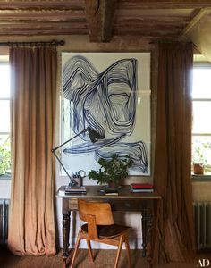 Stylish home office with this oversized art, desk and chair.