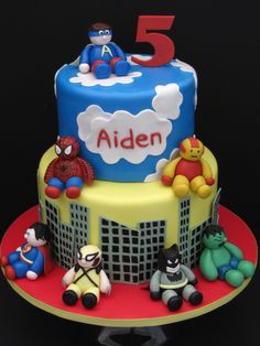 Superhero Birthday Cake - This birthday cake was for a little boy turning 5.  He wanted many different superheroes on the cake, Spiderman, Iron Man, Superman, Wolferine, Batman, The Hulk.  They gave me a picture of a flickr cake that they wanted the cake based off of.  TFL!