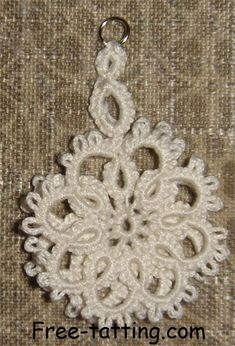 """Free tatting patterns"" This tatted flower can be used as earrings or pendants."