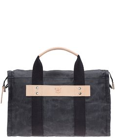 Wax Coated Canvas Duffle by Will Leather Goods is the perfect carry on bag. Fits under a seat, easy to carry, holds a lot, durable and waterproof. LOVE this bag.