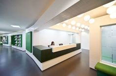Office Reception Design Ideas | reception area with a front desk made of LG Hi-Macs topped with dark ...