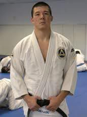 """Henry Akins  Nicknamed """"Jiu Jitsu Super Computer"""" for his knowledge and analysis of the art. Primary instructor at the US BJJ HQ. In addition to learning and teaching in the academy, Henry has had much practical experience with his Jiu Jitsu working some very high profile security gigs for top night clubs and entertainment acts globally.  Going to the fish market in Japan…and seeing all the animals get slaughtered, I got really sad and it touched me and I decided to stop eating meat."""