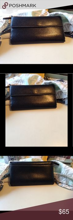 Black Kate ♠️ Spade wallet Beautiful Kate Spade basic black wallet with all the compartments you could wish for, even has an opening for your i7 cell phone...too cute & convenient. kate spade Bags Wallets