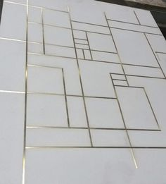Concrete floor tiles with brass inlay
