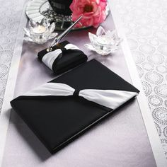 Michaels.com Wedding Department: Black Guest Book and Pen Set Let your guests leave a lasting mark on the event with this charming DIY guest book and pen set. It makes for a stylish reminder of that special day.