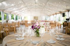 Twinkling lights and glass containers filled with fresh-cut blooms of lavender, purple, pink and white set the tone for Jena and Dave's festive wedding reception at ASHM - by Buttercup: Peach, Pear, Plum Photography.