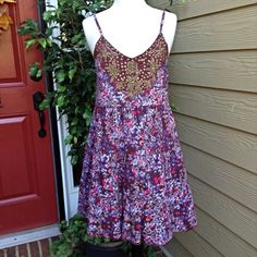 """Free People Floral Dress 🌷HP🌷 tlb1963 6/13/15 Hot pink and blue flowers on a brown background. Beading makes a shield type design on the bust area. 32 inch bust, length is 29"""" not counting adjustable straps. Hand wash and dry flat. 100% cotton. Gorgeous. 🌷Host Pick🌷 maliaalexa 6.15.15 Free People Dresses"""