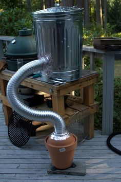 Cold smoker, Now this is an Interesting Concept.. Simple and not very expensive... But you would need Be Careful not to use Galvanized Metal...