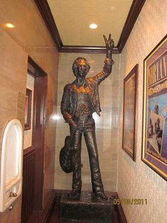 Originally displayed at the 1984 Liverpool International Garden Festival, this statue of John Lennon by sculptor Allen Curran now stands atop the stairwell to the restroom at the Hard Rock Cafe in Washington DC.