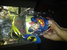 Superhero party favor  Superman cup from Big Lots, Batman Pez from 1.00 Tree and glow stick with. Paper saying Kryptonite Handbook