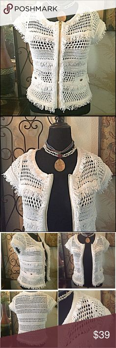"""30% OFF BUNDLES 🌸CACHE Crochet Sweater/Cardigan🌸 This is a gorgeous short sleeved open weave sweater w/fringed trimmings. Wear zipped up or open. I wore this only once over a cami and is in excellent condition. The zipper is gold, there are functioning pockets with a button to close. (They're sewn shut now) Very """"Chanel-esque"""". Measurements:Bust=39"""", Shoulder to hem length=22"""", Shoulder seam to seam width=15"""". Size XL but runs small-Fits best on a Med. to a Lg. in my opinion :) Cache…"""