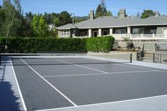 Backyard tennis court.