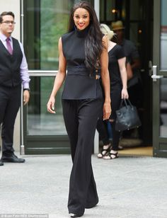 Ciara cuts a chic figure in black backless and flared trousers #dailymail