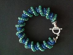 Bracelet in blue and greens - handmade by me in Czech glass seed beads