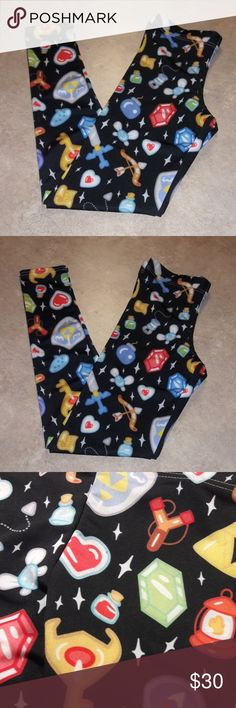 ZELDA PATTERN LEGGINGS Keep all your important weapons and gadgets nearby with these nerdy, Legend of Zelda inspired, gamer, video game, inventory pattern leggings.  Printed in the USA. Made with 89% Polyester, 11% Spandex Pants Leggings