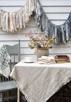I like the cloth on the table. I like linen and different fabrics 'Tempest' fabric garland banner in greys, blues, cream, and taupe - by Untold Imprint. Drop Cloth Curtains, Diy Curtains, Kitchen Curtains, Hippie Curtains, Homemade Curtains, Purple Curtains, Luxury Curtains, Vintage Curtains, Floral Curtains