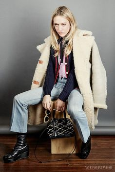 Chloë Sevigny poses for Who What Wear at the 2016 Sundance Film Festival wearing Gucci, a shearling coat, and Levi's jeans