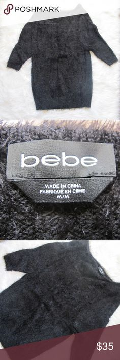 Fuzzy bebe sweater super cozy sweater from bebe.  Size medium.  A shag fuzzy sweater can be worn off the shoulder, has larger neckline bebe Sweaters