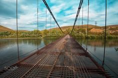 Very deep depth of field in this photo going accross the bridge, very cool!  Creator, Ruslan Olinchuk