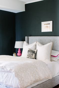 @Alaina Kaczmarski  Chicago Apartment Tour // bedroom // @Jonathan Adler pillow // @Serena &  Lily white duvet and sheets // @Jayson Home  mercury glass // @Euro Style Lighting pink lamps // grey tufted bed and headboard // @west elm nightstand // @Farrow & Ball Pitch Black walls // photography by Stoffer Photography