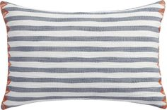 """<span class=""""copyHeader"""">serene stripes.</span> Indigo lines softly ripple on this watercolor-like motif. Piano Nobile designer Isabelle Grizzard Robertson came across the idea while layering and overlapping translucent lines of white and blue paint on paper. The artist loved the design so much, she translated it onto fabric, and we made it into a pillow. Delicately stitched orange triangles edge each end adding the perfect pop of color. Do the math: CB2 low prices include a pillow insert…"""