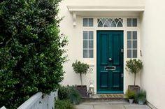 Teal front door. Door: Weathershield Teal Ripple™ Exterior Gloss. Wall & window sill: Weathershield Jasmine White™ Smooth Masonry