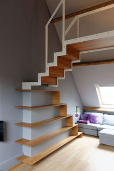 Elegant and space-saving stairs plus a book case! (though not great for children)