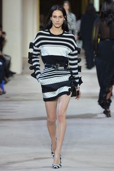 #Spring 2014 RTW … Emanuel Ungaro… spiral ruffles… graphic stripes… black and cream sweater… polka dots with stripes mini skirt… very Couture.