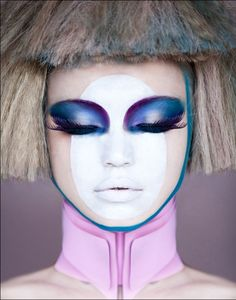 Blue and Purple Makeup with white oval on heart shaped face