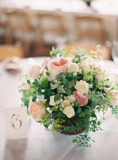 Soft pink and peach wedding colors + greenery | Centerpiece On SMP: http://www.stylemepretty.com/2013/12/02/st-louis-garden-wedding-from-clary-photo | Photography: Clary Photo