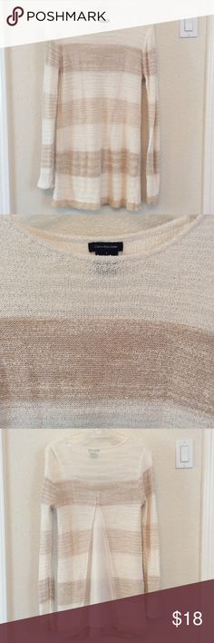 Calvin Klein sweater Tan and white striped Calvin Klein sweater, very comfy and worn twice. Perfect condition. Has cut out with sheer fabric in the back. Pairs great with jeans and boots. Size small. Calvin Klein Jeans Sweaters