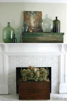 Fall mantel - love the collection of demijohns and the vintage wood box as a fireplace screen eclecticallyvintage.com