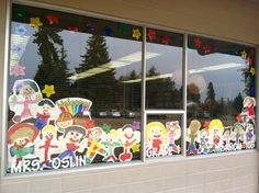 "Self-portraits. A colleague and I call these ""flat people"" Students paint a self-portrait In September and they are displayed in the classroom window until the end of the school year."