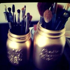 Great idea! Spray paint bell jars gold and use to store make-up brushes or products