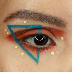 Makeup by Jacquie Bear. Instagram @bacquiejear. Geometric graphic eyeliner with some red-orange eyeshadow. Products by Toofaced, Nyx Cosmetics, and Kat Von D.