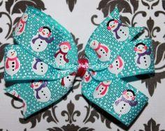 Blue snowmen print pinwheel hair bow.