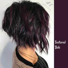 Textured Bob with purple highlights on dark hair