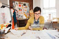 Stock Photo : Fashion designer working in her studio