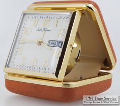 Seth Thomas travel clock from the 1950s, featuring an alarm and a day+date calendar, in a leatherette, brass, and YGF case.  To see this and the other four listings added today (a gold pocket watch chain, a Shriners-themed stick pin, a Hamilton wrist watch, and a railroad-grade Hamilton pocket watch), visit our Auctions page here: http://stores.ebay.com/PM-Time-Service/_i.html?rt=nc&LH_Auction=1