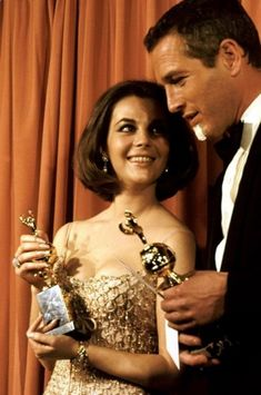 1966 Golden Globe Awards - Natalie Wood  Paul Newman. Now this has to be one of the rarest shots in Hollywood history--arguably, the two most gorgeous people in movies in one photograph. Amazing that people really can look like that--Helen of Troy and Adonis.