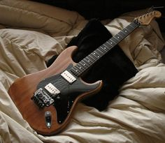 Refinishing the Stratocaster → Then Dremelled out the pickups to make room for humbuckers.