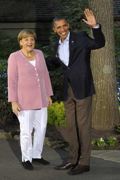 German Chancellor Angela Merkel is welcomed by U.S. President Barack Obama at the G8 summit in Camp David, May 18, 2012.